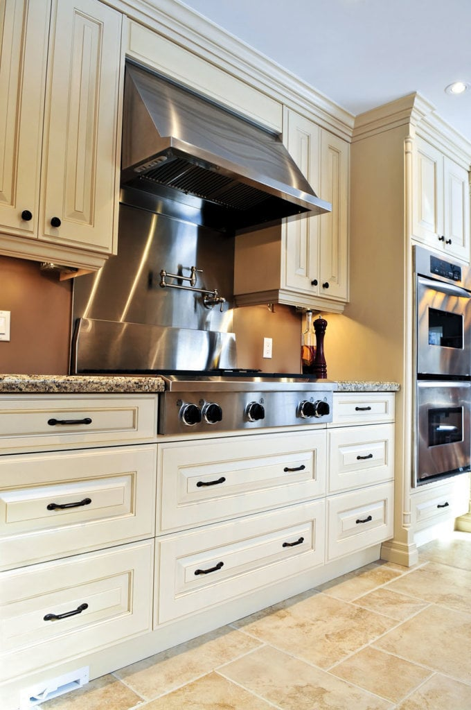 Interior of modern luxury kitchen with stainless steel appliances