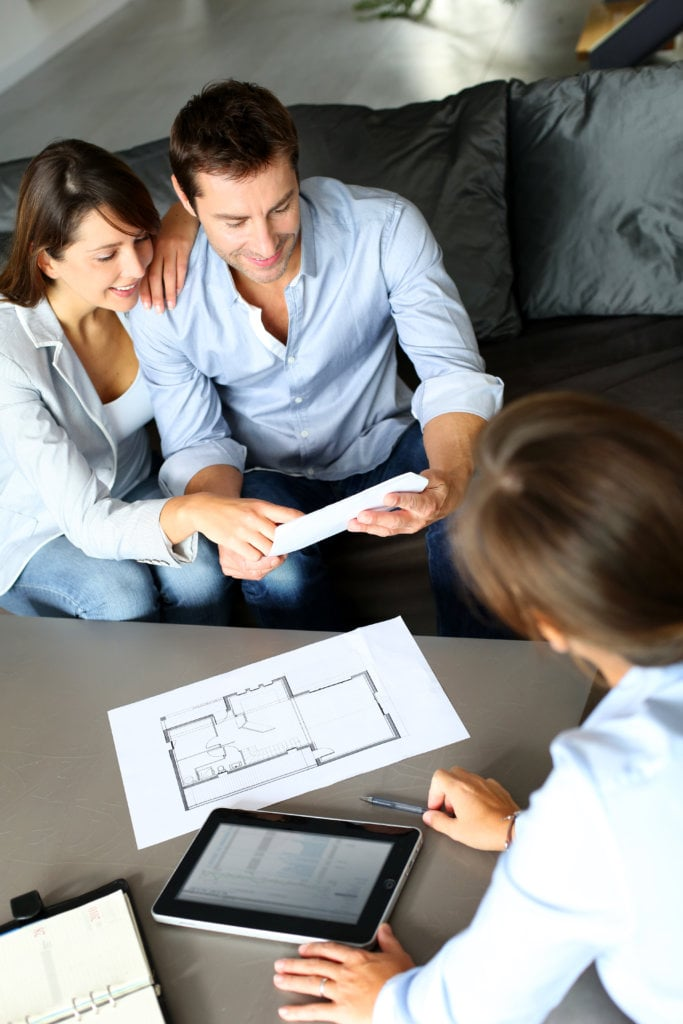 Couple meeting contractor for after a consultation request.
